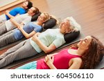 senior with a group meditating... | Shutterstock . vector #604506110