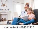 happy father and daughter... | Shutterstock . vector #604521410
