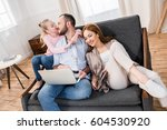 happy family sitting embracing... | Shutterstock . vector #604530920