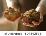 man holding piece of bread ... | Shutterstock . vector #604542536