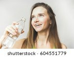happy woman with water | Shutterstock . vector #604551779