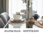 glass dining table with table... | Shutterstock . vector #604556264