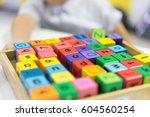 a boy learns the alphabet. | Shutterstock . vector #604560254