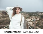 smiling adventure woman with... | Shutterstock . vector #604561220