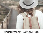 adventure woman with curly... | Shutterstock . vector #604561238