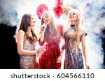 three gorgeous young women in... | Shutterstock . vector #604566110