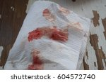 white paper with red blood stain | Shutterstock . vector #604572740