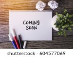 coming soon word with notepad... | Shutterstock . vector #604577069