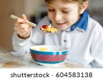 little school kid boy eating... | Shutterstock . vector #604583138