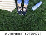 feet of a young girl on a... | Shutterstock . vector #604604714