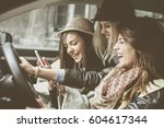 three best friends in the car... | Shutterstock . vector #604617344
