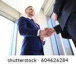 business people shaking hands ... | Shutterstock . vector #604626284