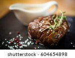 filet mignon served on a stone... | Shutterstock . vector #604654898