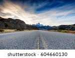 the road approaching the town... | Shutterstock . vector #604660130