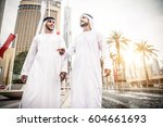 arabic businessmen in dubai   Shutterstock . vector #604661693