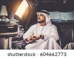 arabic businessmen in dubai | Shutterstock . vector #604662773