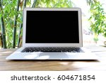 laptop with blank screen on... | Shutterstock . vector #604671854