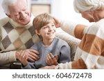happy grandparents taking care... | Shutterstock . vector #604672478
