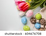 painted easter eggs and bouquet ...   Shutterstock . vector #604676708