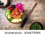 hawaiian salmon poke bowl with... | Shutterstock . vector #604679084
