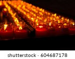 row of flame of candle in a... | Shutterstock . vector #604687178