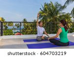 yoga instructor conducts... | Shutterstock . vector #604703219
