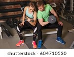 sport fit couple at gym. work... | Shutterstock . vector #604710530