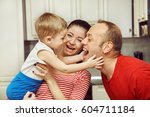 family playing with child at... | Shutterstock . vector #604711184