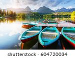 boat on the dock surrounded... | Shutterstock . vector #604720034