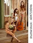 young happy women in bohemian... | Shutterstock . vector #604723046