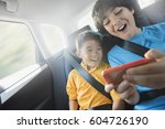 two children travelling in the... | Shutterstock . vector #604726190