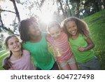 children playing outdoors in... | Shutterstock . vector #604727498