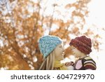 a woman lifting a child into... | Shutterstock . vector #604729970