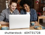 two female students working on... | Shutterstock . vector #604731728
