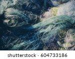 pile of commercial fishing nets | Shutterstock . vector #604733186