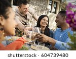 friends around a table  men and ... | Shutterstock . vector #604739480