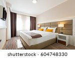 Stock photo interior of a modern hotel bedroom 604748330