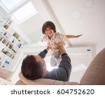 little son playing with father... | Shutterstock . vector #604752620