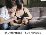 a same sex couple  two women... | Shutterstock . vector #604754018