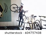 a man working in a bicycle... | Shutterstock . vector #604757438