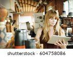 woman in a shop  holding a... | Shutterstock . vector #604758086