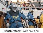 knight in full armor fighting... | Shutterstock . vector #604760573