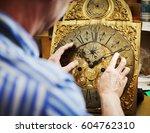 A Clock Maker Moving The Hands...