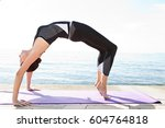 active female stretching on... | Shutterstock . vector #604764818