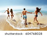 group of happy four friends... | Shutterstock . vector #604768028