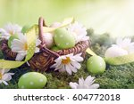 easter basket on the grass. | Shutterstock . vector #604772018