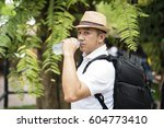 asian man is drinking water... | Shutterstock . vector #604773410