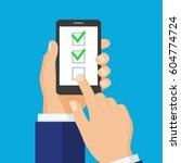 checkboxes on smartphone screen.... | Shutterstock .eps vector #604774724
