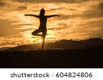 silhouette asia woman yoga on... | Shutterstock . vector #604824806