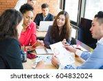 multiethnic business people... | Shutterstock . vector #604832024